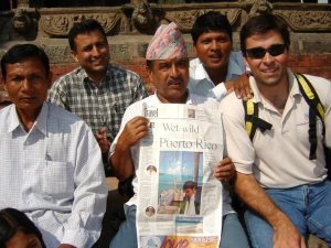 Jeff and his Nepali friends, holding up the Charlotte Observer, back in 2005