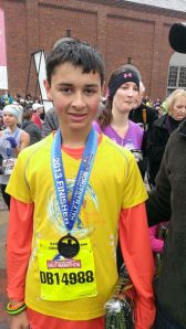 Alex wearing his finisher's medal