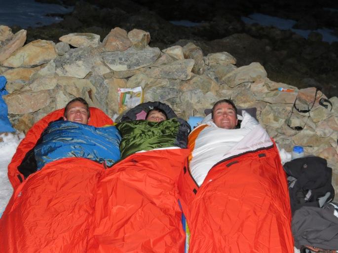 Jeff Gaura, Alex Gaura and Michael Larsson sleeping on a glacier in New Zealand