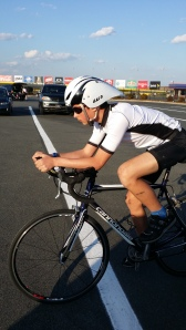 Alex Gaura riding on a Cannondale bike, warming up at the Charlotte Motor Speedway