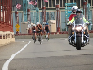 Jeff Gaura at the USAT Duathlon National Championship, climbing over the Mississippi River on a steep bridge