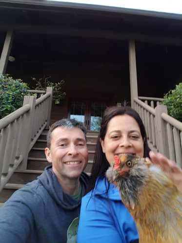 Jeff and Linda Gaura, starting Threshold Academy.  Sitting on the front porch of 5101 Sugar and Wine Rd, with their chicken Goldilocks.
