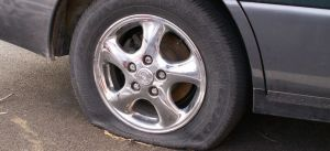 Newburgh-Tow-Truck-Company-845-764-8865-fixing-a-flat-tire-on-disabled-car
